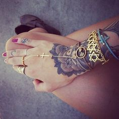 gorgeous bracelet/ring and love the tats!