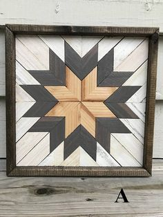 Handmade Geometric Wood Art. Each piece is stained, cut, and arranged to create an eye-catching pattern to enhance any space. Perfect for a housewarming, anniversary, Christmas, wedding, or birthday gift! • Piece measures approximately 12 x 12 inches. • Hanging hardware included.