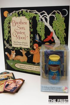 "Sanctity Pictured merchandise in the Gift Shop offers gifts galore for the little ones! ""The Brother Sun, Sister Moon"" book contains the simple hymns by Saint Francis of Assisi with beautiful illustrations by Pamela Dalton for $17.99. The Shining Light Dolls each represent the Virgin Mary from across the world and are available in our gift shop for $15.50. A variety of handcrafted retablos are available in pocket size for $6 and ornament size for $16."
