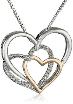 A combination of sterling silver and pink gold open-heart shapes create this playful pendant design. The two-tone display generates a unique metallic contrast which emphasizes the sparkle of the round diamond accents. Resting along an included 18-inch box chain that fastens with a spring-ring clasp, this pendant will remain securely in place close to her own heart. Pendant necklace with intertwined rose gold, diamond, and sterling silver hearts Box chain with spring-ring clasp All our…