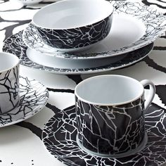 KELLY WEARSTLER | TRACERY WHITE ON BLACK SET. Chic casual china.