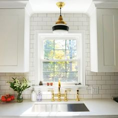 The sink in an AD editor's renovated kitchen | The Schoolhouse Brass Pendant from Barn Light Electric