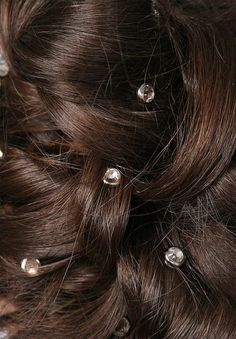 Love sparkles in hair or little flowers.
