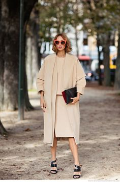 Candela Novembre- blush nude duster coat, pencil skirt, top, strap heels, red cat eye sunglasses