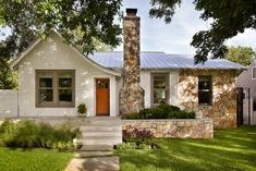 Chioco Design, Casey Dunn Photography | Mid-century cottage with a standing-seam metal roof and stone work.