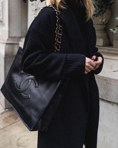 All black outfit with oversized Chanel tote bag