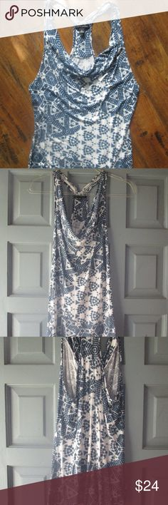 BANANA REPUBLIC shades of blue Aztec print BANANA REPUBLIC shades of blue Aztec print tank top. Easy breezy top to throw on with your favorite jeans or white shorts. Love the drape detail in front and the racer back with style in the back. Banana Republic Tops Tank Tops