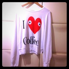 WildFox I Love Coffee Sweatshirt ❤️☕️❤️☕️ WildFox I Love Coffee sweatshirt  in clean white is a total wake me upper! Super cute...and there are eyes in the hearts!! Please see 2nd picture for product details. I'm keeping one for myself!!! ❤️☕️❤️☕️ Wildfox Tops Sweatshirts & Hoodies