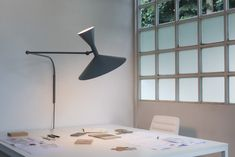 LAMPE DE MARSEILLE Designed by Le Corbusier for the Unité d'Habitation of Marseille in 1950/1952, it is an adjustable wall lamp with plug. Spun aluminium diffuser. Available with matt grey or white wash body, with white internal diffusers. Direct and indirect lighting output. Double switch on the cable, for a functional and adjustable light output.