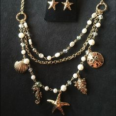 NWOT necklace and earings gold tone 3 strand seashell necklace. gold tone star fish earrings. new never worn.   no holds no trades Jewelry Necklaces