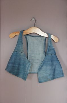 DIY: vest from old jeans, wasn't too hot on this til I saw one of the girls on Pretty Little Liars wearing a denim vest, now of course I can't wait to make one.  I think this girls painting on it was a little 90s though