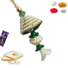 Pearl Lumba Rakhi. #lumba #Rakhi #RAkhiGifts#SendRakhi#OnlineRakhi#rakhitoindia Rakhi To India, Rakhi Online, Rakhi Gifts, Drop Earrings, Pearls, Christmas Ornaments, Holiday Decor, Home Decor, Xmas Ornaments