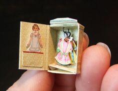 TINY Paper Doll with wardrobe....