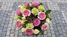 A bouquet of roses, dianthus, gerbera, eustoma, viburnum