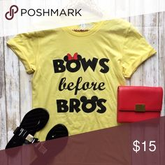 NWT Bows Before Bros Disney Yellow Flowy Fit Tee ✨ Show your love for your fellow bow girls in this great Bows Before Bros disney inspired yellow flowy fit tee shirt. Unisex / Boyfriend Fit for a flowy boxy fit. Base Shirt from Bella + Canvas. ✨Brand New with Tags. ✨ 100% Cotton Tops Tees - Short Sleeve