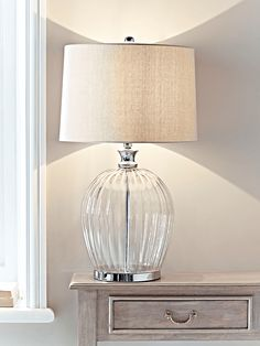 With an elegant fluted glass base and silver fitting details, our generously sized table lamp has a natural cotton shade for a soft, warm glow. Table Lamps Uk, Sofa Table Decor, Large Table Lamps, Ceramic Table Lamps, Bedroom Lamps, Bedroom Lighting, Glass Bedside Lamps, Glass Lamps, Cream Living Rooms