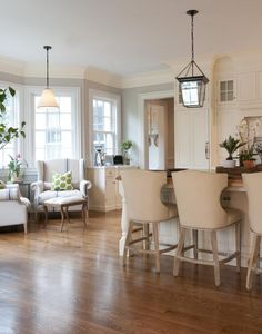 comfortable bar stools and sitting area in the kitchen to relax while things cook or look up new recipes