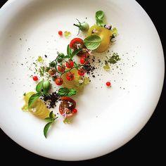 """Tomato salad"". . Again tomato salad. . Simpleeasy but tasty. . Homemade tomatoes/3kinds of basil and flower/black olive/freez-dried pesto/olive and basil oil bubbles. . #自家製 #トマト #バジル #サラダ #新鮮 #野菜 #homemade #garden #tomato #basil #salad #easy #simple #yum #theartofplating #gastroart #chefstalk #gourmetartistry #chefsofinstagram #foodstarz #dontshootthechef #hipsterfoodofficial #feedfeed #flower #vegan #vegetable #foodart #expertfoods #kresios #tadashitakayama by tadashi_takayama"