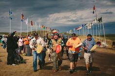 Members of the Anishinabek Nation sing as they enter the Standing Rock Sioux tribe's protest encampment.