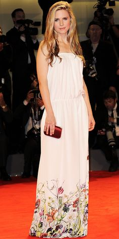 Brit Marling walked the red carpet at the Venice Film Festival in a floral Gucci column and burgundy clutch.