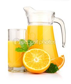 Jug, glass of orange juice and orange fruits with green leaves i