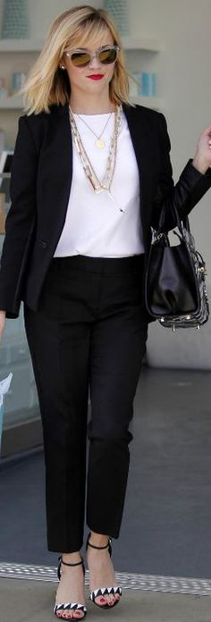 Reese Witherspoon: Purse – Jason Wu  Sunglasses – Oliver Peoples  Shoes – Sergio Rossi