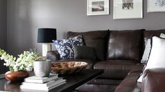 Grey walls with leather couches.