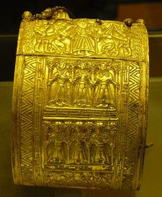 Etruscan Gold: Armband and Breastplate . The Regolini-Galassi tomb is an elaborate Etruscan family tomb located in Caere, an ancient city in Italy. It dates to between 600-650 BC. Built by a wealthy family & stocked with bronze cauldrons & gold jewelery of Etruscan origin in asian style. The tomb was discovered in 1836.