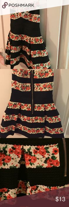 Floral and black mini dress. Juniors medium mini dress. Fully stretch material and strapless. Pleated pattern all around skirt area. Perfect dress for the perfect little girl Touch me Dresses