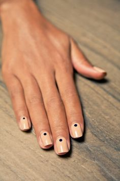 square, nude nails with a polka dot