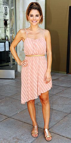 Maria Menounos' muted-hued dress including a gold belt and matching metallic sandals.
