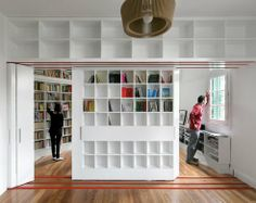 Sliding Library Instantly Creates Extra Studio at Hip Buenos Aires Apartmen Library Shelves, Library Wall, Wall Bookshelves, Bookcase, Small Apartments, Small Spaces, Long Room, Interior And Exterior, Interior Design