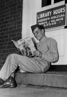 Publicity photograph taken during the Second World War of a soldier sitting on the step of Fort Slocum's library, then located in Building reading a movie fan magazine. History Of Reading, World War Two, The Past, Two By Two, African, Photograph, Photography, World War Ii, Wwii