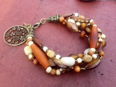 Seed and shell beaded bracelet