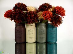 """Quart size Kerr wide mouth mason jars are painted and distressed for a vintage, beach and cottage look.   Set of 4 jars for $32. The colors are eggplant, olive, dark grey and dark blue.  The jars are 6 1/2"""" tall and 3"""" wide at the mouth.  I pride myself in creating unique colors and styles of painted and distressed shabby chic mason jars. """"Beach Blues"""" is the home of the original! ™ This is a unique and one of a kind color combination and title created..."""