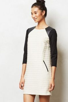 This is a cery professional , yet very hip dress. To the office to cocktails to Sunday brunch.. An every where dress.