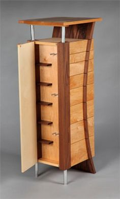 Made from maple and walnut by Robb Helmkamp at Kampstudio in Asheville NC! The armoire is 48 tall with a top measuring 16 x This beautiful 8
