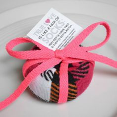These adorable sock ball charity wedding favors are the perfect budget friendly and practical gift! With free printable!