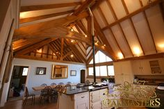 Oak vaulted roof. This is the kitchen of your dreams with a high oak ceiling and visible oak frame in a stylish county home.