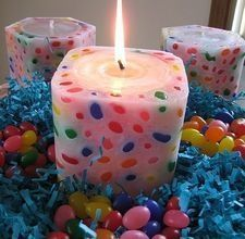 Jelly bean candles are seasonally festive and glow like stained glass when lit. They're easy to make with a few basic candle making supplies....