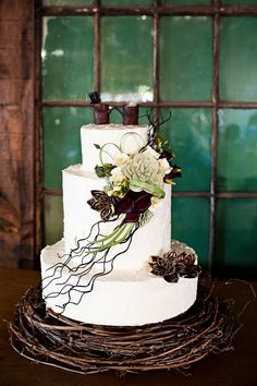 Gorgeous cake for industrial motif Seattle wedding, Herban Feast Sodo Park - Cake by The People's Cake, photo by Laurel McConnell via junebugweddings.com