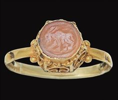 A ROMAN GOLD AND CARNELIAN FINGER RING   CIRCA 5TH-7TH CENTURY A.D.