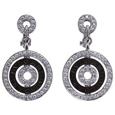 "Bulgari Diamond Astrale Earrings. A pair of diamond in 18k white gold ""Cerchi"" ""Astrale"" earrings by Bvlgari. Contains black ceramic hallmarked disc suspended between two diamond in gold rings. Italy, 20th century"