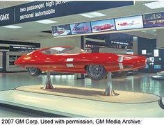 This futuristic-looking, twopassenger automobile was part of GM's Futurama II exhibit at the New York World's Fair in 1964. A press release noted that one of the futuristic cars at the exhibit 'anticipates the day when the family will drive to the super highway, turn over the car's controls to an automatic, programmed guidance system and travel in comfort and absolute safety at more than twice the speeds possible on today's expressways.'