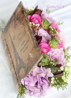 use an old book to make this (take out pages, then line with plastic) Vintage Flower Arrangements