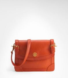 Love this Tory Burch orange clutch for this spring/summer.  Simple and classic.