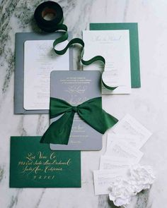"A Timeless New England Wedding at a Newport Mansion | Martha Stewart Weddings - ""We wanted something serious but also celebratory for the occasion, so the mix of charcoal gray, dark green, and gold details was perfect,"" Lissy says of the stationery suite, which was designed with help from wedding planner and event designer Lisa Vorce. This classic suite contained a letterpressed save-the date with a sketch of the venue."