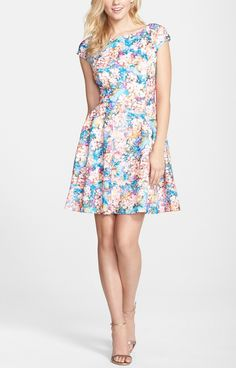 Pretty floral fit & flare dress! Soft floral blooms pattern this charming party dress while allover laser-cuts add spunky dimension.