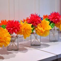 Lighthearted diy paper flower centerpieces.