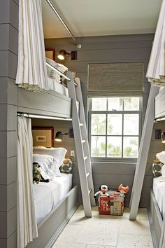 In the boys' bunk room in our 2012 Ultimate Beach House, each bunk has a privacy curtain and a sconce controlled by an individual switch so kids can stay up and read or snooze as they please.